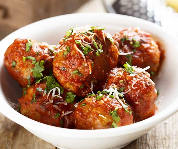 meatballs in a bowl with tomato sauce