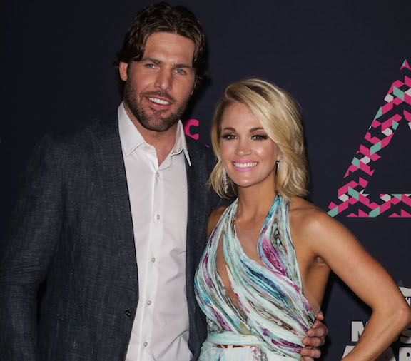 carrie underwood and mike fisher on the red carpet