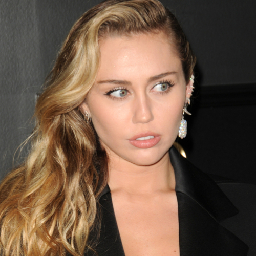 Miley Cyrus Basically Just Flashed The Camera In A High-Slit Dress–Did She Forget Underwear?