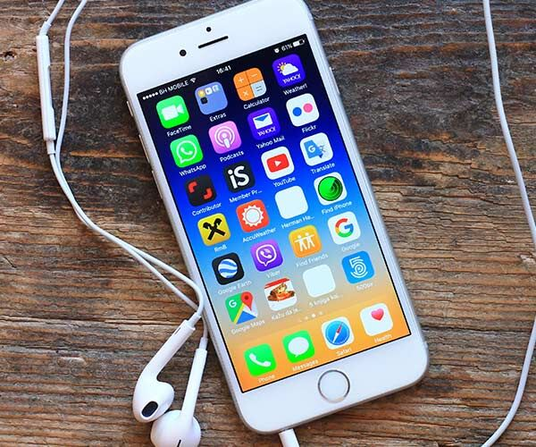 iphone on a table with apple headphone