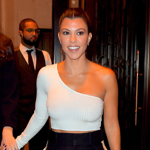 You May Need To Sit Down Before You See Kourtney's Topless Shoot