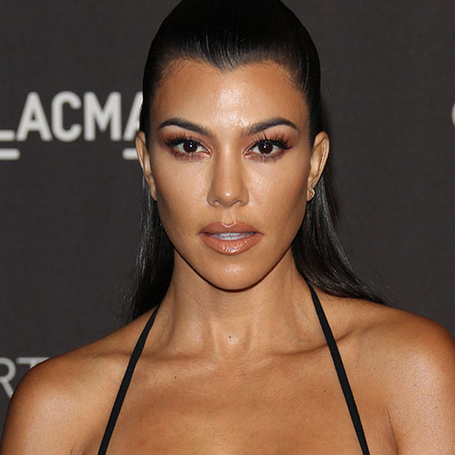 Kourtney Kardashian's Curves Are On Full Display In This Sexy Bodysuit--Did We Mention It's COMPLETELY Sheer?!