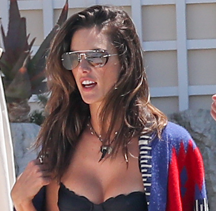 We May Have Just Found The Most Bizarre Bikini Top Trend Of Summer--It's SO Revealing!