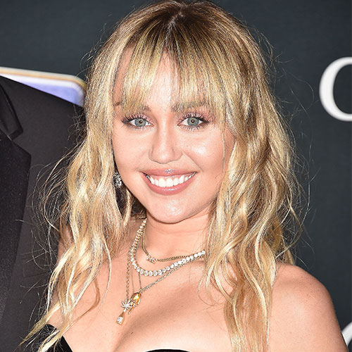 You May Need To Sit Down Before Looking At These Topless Photos Of Miley Cyrus That Were Just Released