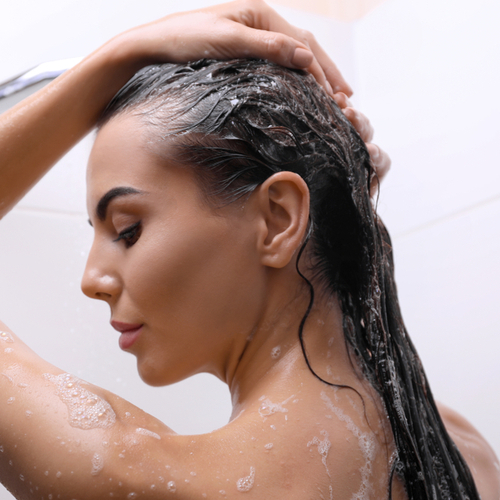 The One Product You Should START Using To Prevent Thinning Hair, According To A Dermatologist