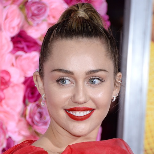 Miley Cyrus Put Her Curves On FULL Display In This Red Latex Jumpsuit—It's INSANE!