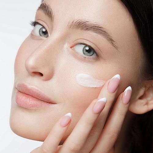 Woman applying eyecream