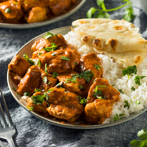 Tikka marsala and rice in a bowl.