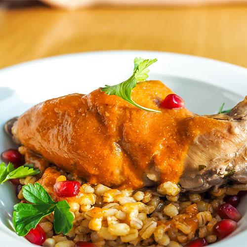 Harissa chicken in a bowl.