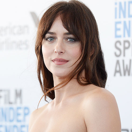 We're Surprised Dakota Johnson Didn't Have A Major Wardrobe Malfunction In This Tiny Top—It Barely Covers Her Chest!