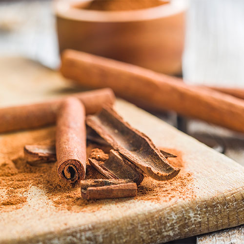 Cinnamon sticks on a table.