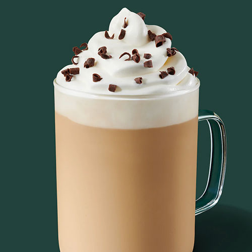 Glass of hot chocolate with whipped topping