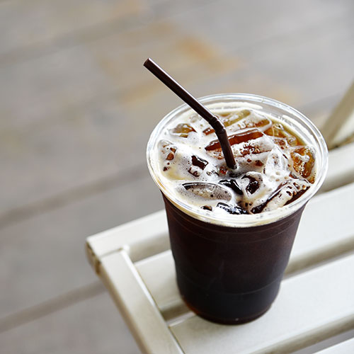 Ice coffee in a plastic cup.