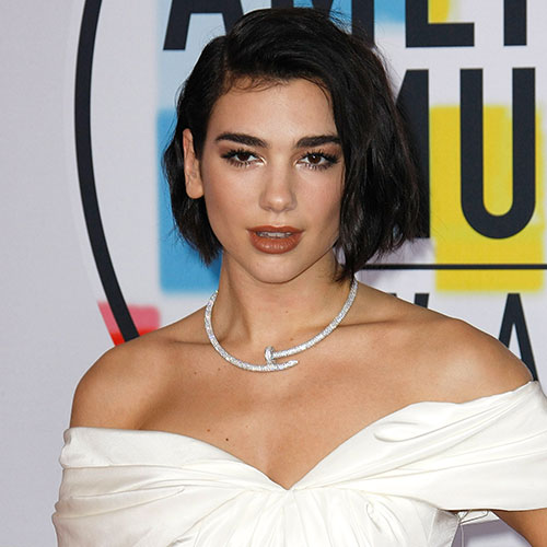 Dua Lipa Really Put It ALL On Display In This Pink Mini Dress–She's Barely Covered!