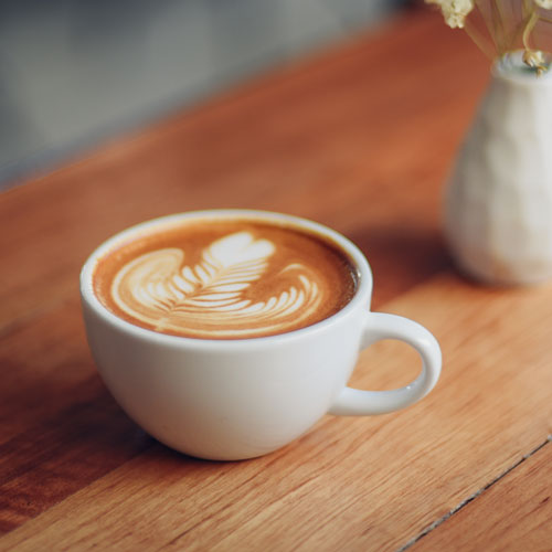 A latte in a white cup.