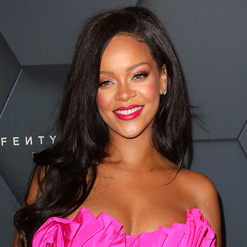 Rihanna's Mini Dress Is Too Hot To Handle–See The Pics!