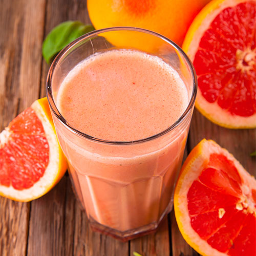 Red grapefruit and pineapple smoothie.