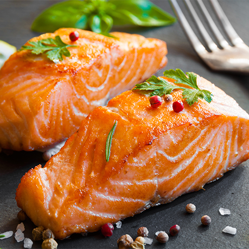 Cooked salmon with seasonings.