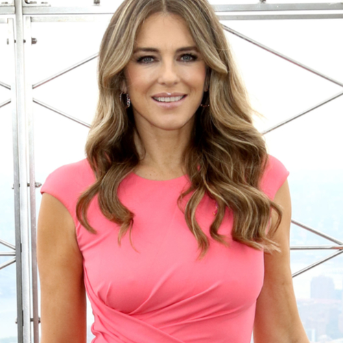 We Can't Believe How Hot Elizabeth Hurley Looked In This White One-Piece Bathing Suit