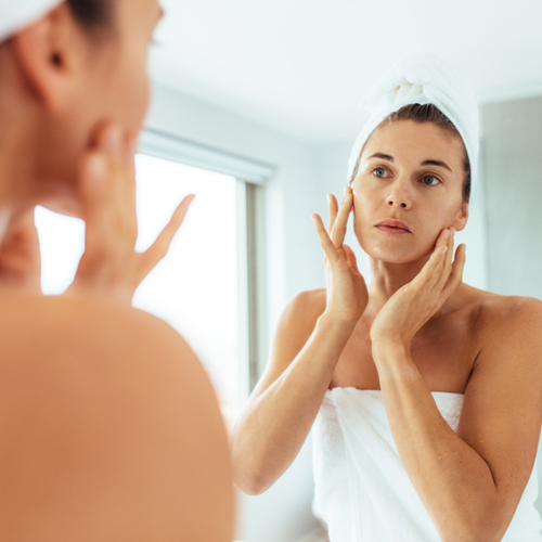 looking at skin in mirror