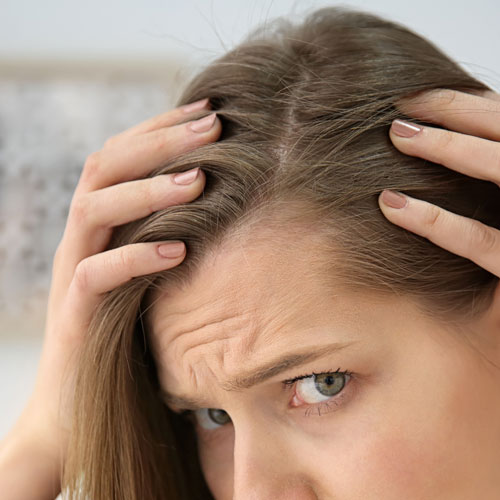 The Cheap Natural Product Experts Swear By To Stop Thinning Hair For Good