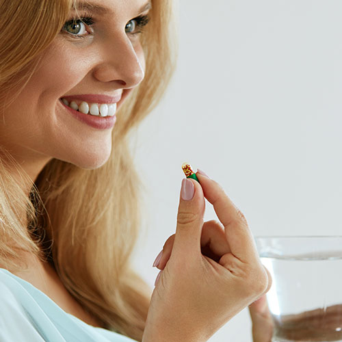 woman taking vitamin