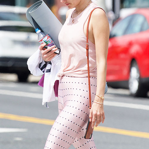 The One Pair Of Shoes Celebs Are Wearing With Leggings To Look SO Chic—They're Not Sneakers!