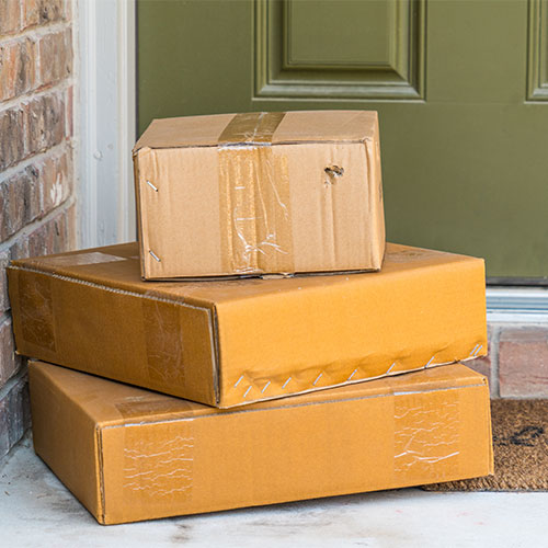 We Asked An Expert: Should You Wipe Down Packages That Come In The Mail?