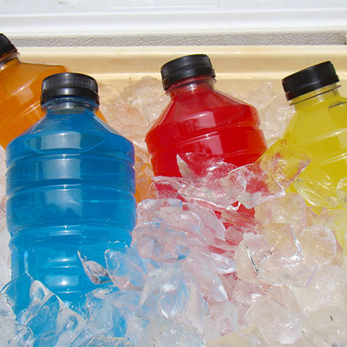 A variety of sports drinks on ice.