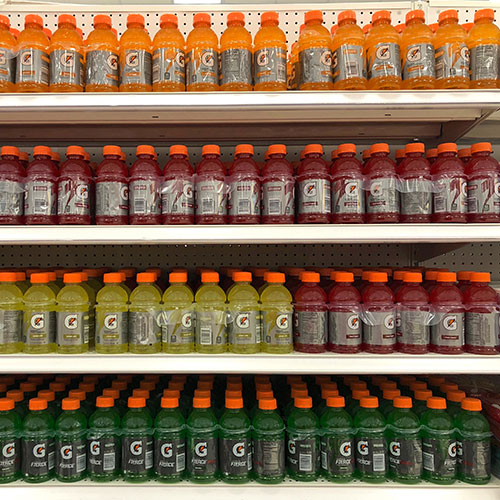 Sports drinks on a grocery store shelf.