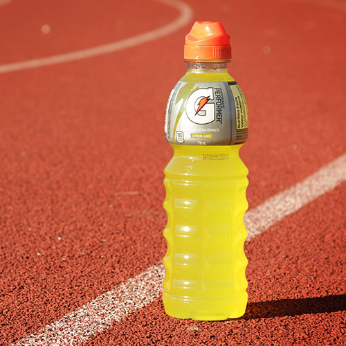 A bottle of Gaterade on a track.