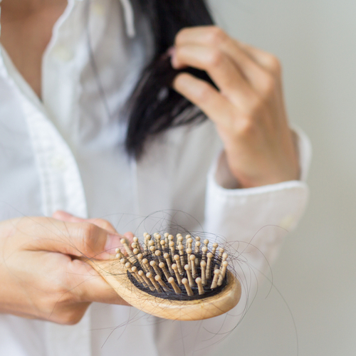 The One Thing You Need To Do EVERY Week To Prevent Hair Loss, According To A Dermatologist