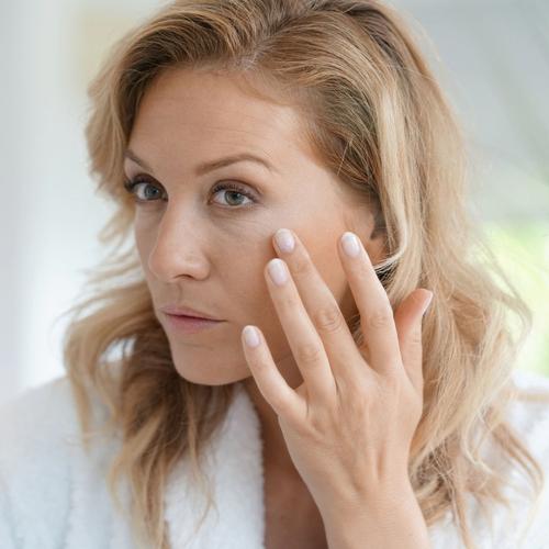 woman applying moisturizer