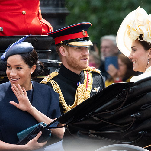 Prince Harry, Meghan Markle, and Kate Middleton in a car.