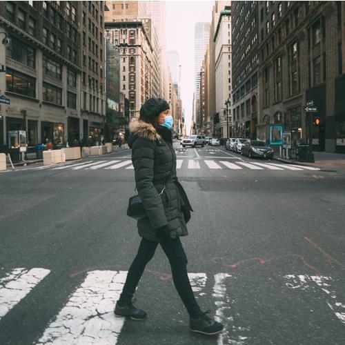 woman walking in mask
