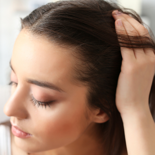 The Scary Reason Your Hair Keeps Thinning, According To Experts