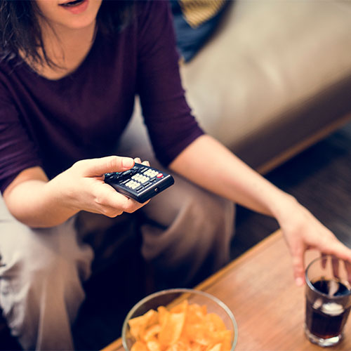 woman holding t.v. remote