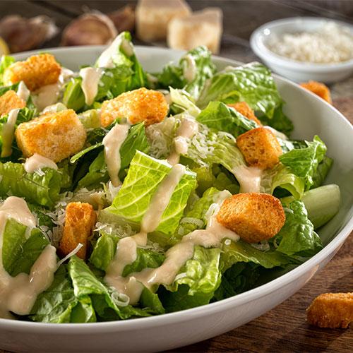caesar dressing on salad
