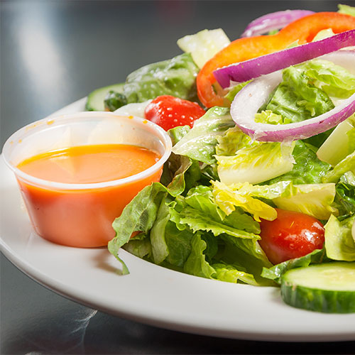 french dressing on side of salad