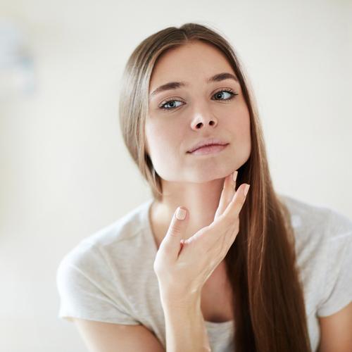 woman looking at face