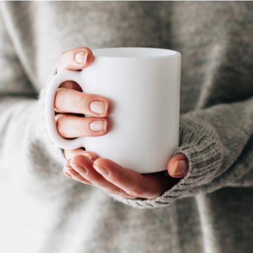 woman holding mug