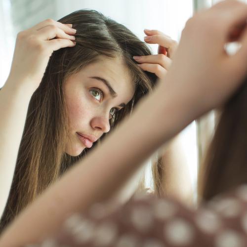 woman checking hair