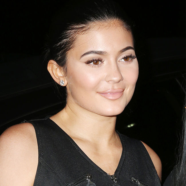 Kylie Jenner's Boobs Are Literally Spilling Out Of This Top--How Is This Even Allowed?!