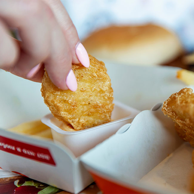 The Scary Reason Doctors Say You Should Never Order Chicken Nuggets At Fast Food Restaurants