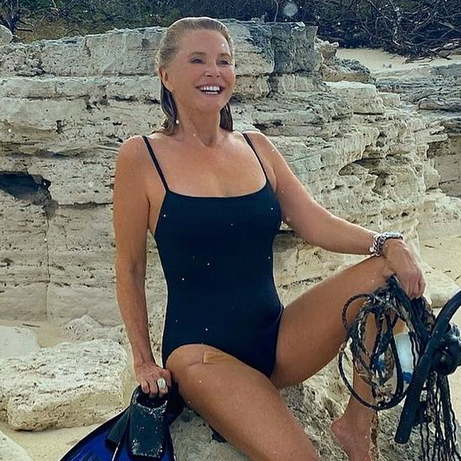 Christie Brinkley Just Let It All Hang Out In A Sexy Black One-Piece--She's Never Looked Better!