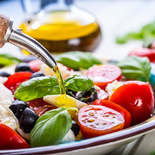 dressing salad with olive oil