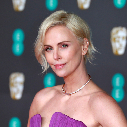 Charlize Theron's Mini Dress Is Too Hot To Handle–See The Pics!