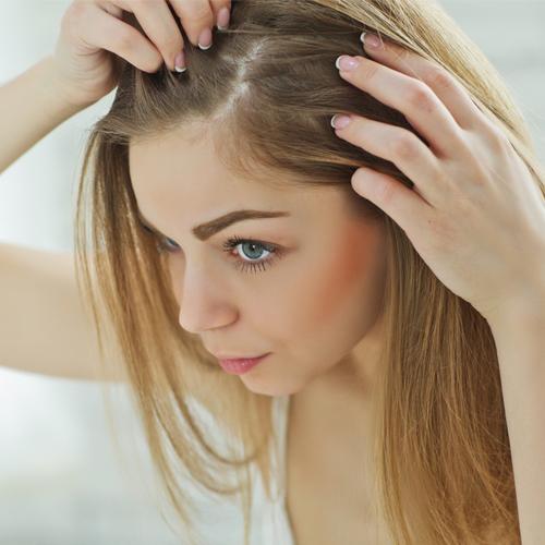 woman looking at hair