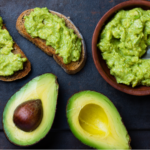 halved avocados side by side with guacamole